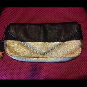 Pour La Victoire gold black stripe leather clutch